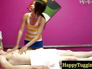 Real asian masseuse giving handjob