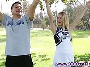 Teen cheerleader tugs rod