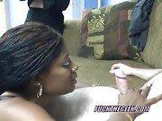 Ebony swinger Honey swallows a stiff white cock