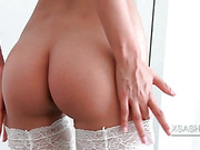 Sasha in stockings stretches her bald cunt in the mirror