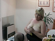 Big titted mature hottie fucking herself on the desk