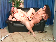 BBW lesbo duo fucking a double dildo on the couch