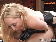 Corsetted blonde slut riding a dick